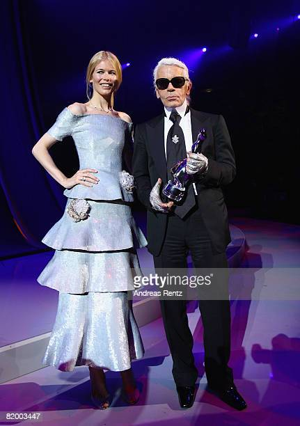Claudia Schiffer presents Karl Lagerfeld with a lifetime achievement award at the ELLE Fashion Star award ceremony during Mercedes Benz Fashion week...