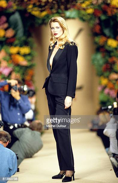 Claudia Schiffer walks on the catwalks at YSL High Fashion Show Autumn/Winter 199697 during the fashion week 1996 in Paris France