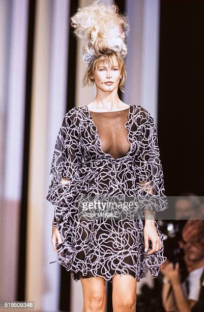 Claudia Schiffer walks the runway at the Karl Lagerfeld Ready to Wear Spring/Summer 19931994 fashion show during the Paris Fashion Week in October...