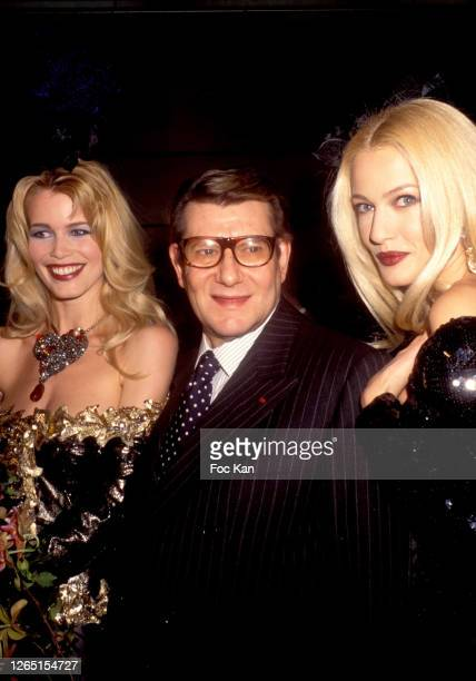 Claudia Schiffer, Yves Saint Laurent and Karen Mulder attend a Yves Saint Laurent Show during A Paris Fashion Weeks in the 1990s in Paris, France.