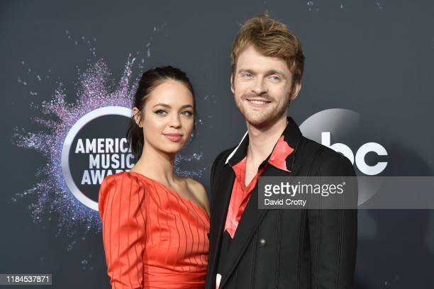 Claudia Sulewski and Finneas O'Connell attend 47th Annual AMA Awards Arrivals at Microsoft Theater on November 24 2019 in New York City