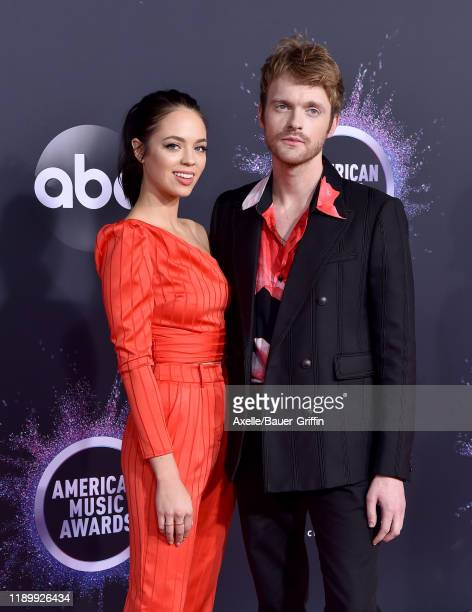 Claudia Sulewski and Finneas O'Connell attend the 2019 American Music Awards at Microsoft Theater on November 24 2019 in Los Angeles California