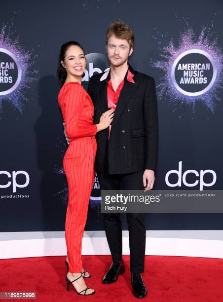 Claudia Sulewski and Finneas O'Connell attends the 2019 American Music Awards at Microsoft Theater on November 24 2019 in Los Angeles California