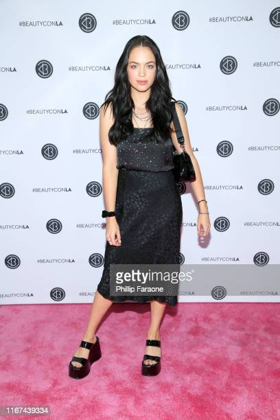 Claudia Sulewski attends Beautycon Los Angeles 2019 Pink Carpet at Los Angeles Convention Center on August 11 2019 in Los Angeles California