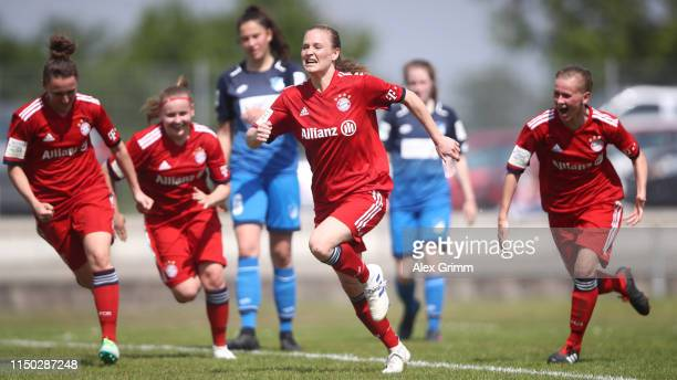 Claudia van den Heiligenberg of Muenchen celebrates her team's third goal with team mates during the 2 Frauen Bundesliga match between TSG 1899...