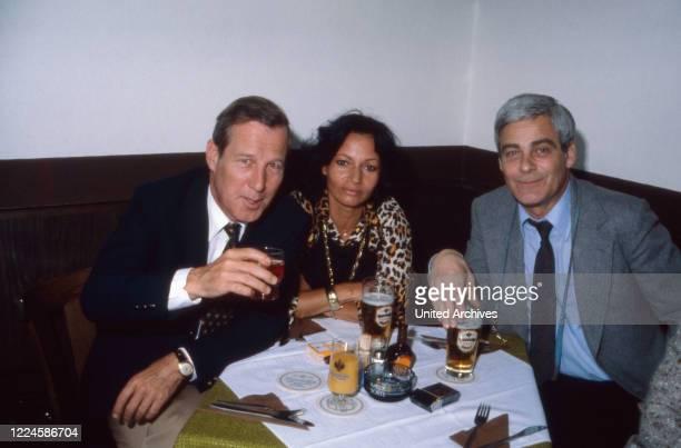Claudia Wedekind with Hansjoerg Felmy and Karl Heinz Vosgerau at the wedding of actor friend Wilfried Blasberg with Mechthid Pruessner, Germany,...
