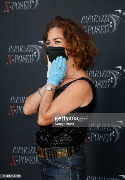 Claudia Wells attends the Premiere of Paparazzi XPosed on June 15 2020 in Los Angeles California