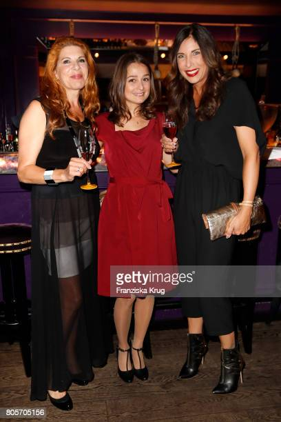Claudia Wenzel Sarah Alles and Alexandra Polzin attend the Annabelle Mandeng Hosts Ladies Dinner In Berlin on July 2 2017 in Berlin Germany
