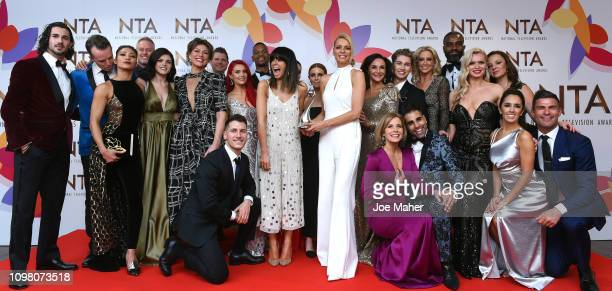 Claudia Winkleman Tess Daly and Stacey Dooley and the cast of Strictly Come Dancing pose with the Talent Show Award in the winners room during the...