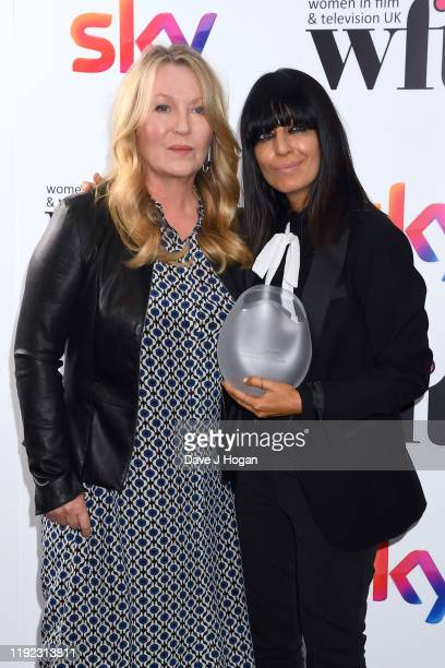 Claudia Winkleman, winner of the Eikon Presenter Award and presenter Kirsty Young during Women in Film & TV Awards 2019 at Hilton Park Lane on...