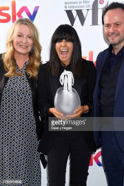 Claudia Winkleman, winner of the Eikon Presenter Award, presenter Kirsty Young and David Morrissey during Women in Film & TV Awards 2019 at Hilton...