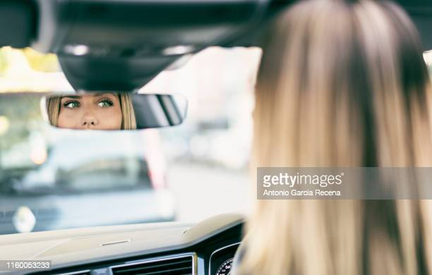 claudiamozas.jpg - rear view mirror stock pictures, royalty-free photos & images