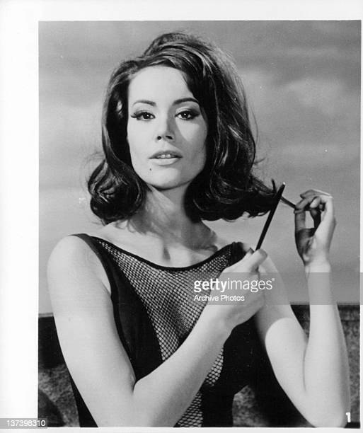 Claudine Auger combing her hair in a scene from the film 'Thunderball' 1965