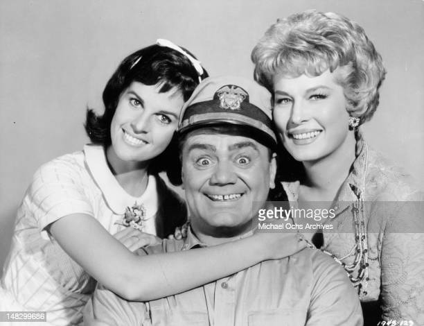 Claudine Longet Ernest Borgnine and Jean Willie all close for a photograph in a scene from the television series 'McHale's Navy' 1962