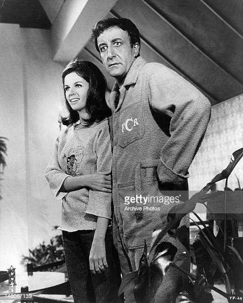 Claudine Longet standing next to Peter Sellers in a scene from the film 'The Party' 1968