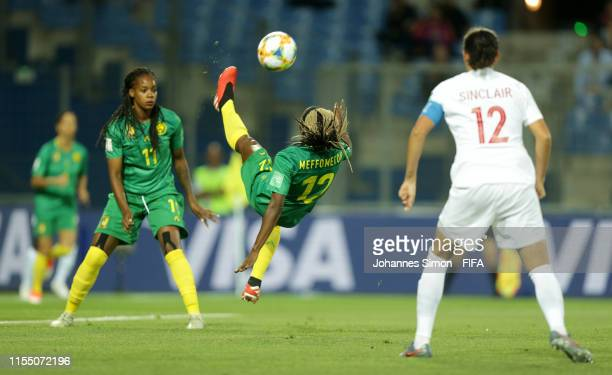 Claudine Meffometou of Cameroon attempts an over head kick during the 2019 FIFA Women's World Cup France group E match between Canada and Cameroon at...