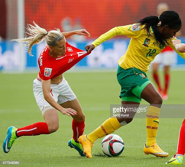 Claudine Meffometou Tcheno of Cameroon pulls the jersey of Lara Dickenmann of Switzerland during the FIFA Women's World Cup Canada Group C match...