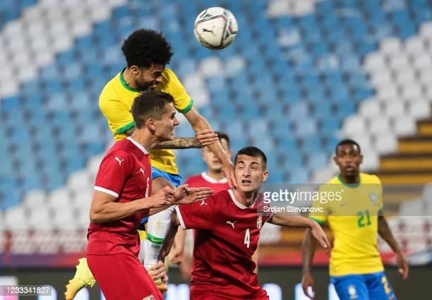 Claudinho of Brazil in action against Damjan Danicic and Danilo Mitrovic of Serbia during the International football friendly match between Serbia...