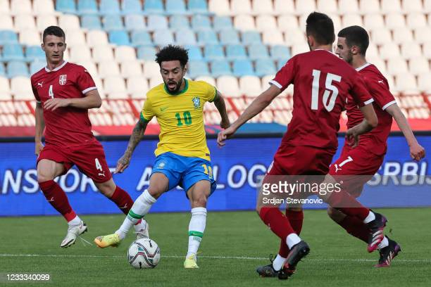 Claudinho of Brazil in action against Danilo Mitrovic and Nikola Marijanovic of Serbia during the International football friendly match between...