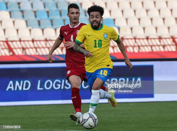Claudinho of Brazil in action against Danilo Mitrovic of Serbia during the International football friendly match between Serbia U21 and Brazil U23 at...