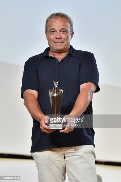 Claudio Amendola poses with the Giffoni Award during Giffoni Film Festival 2017 Day 5 on July 18 2017 in Giffoni Valle Piana Italy