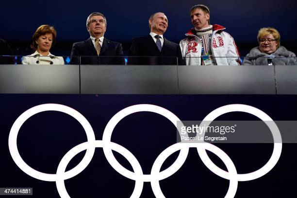 Claudio Bach, Thomas Bach, President of the IOC, Russian President Vladimir Putin and Russian Bobsleigh pilot Alexander Zubkov attend the 2014 Sochi...