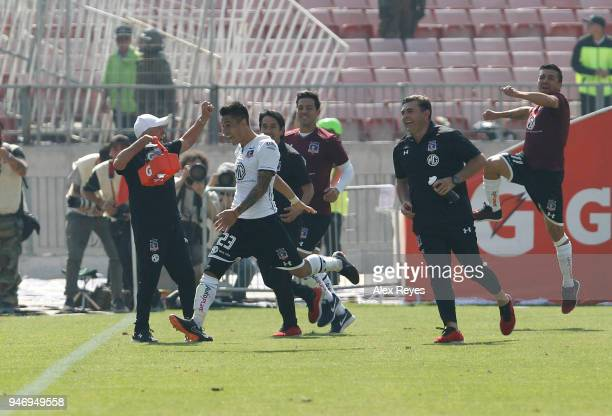 Claudio Baeza of Colo Colo celebrates after scoring the third goal of his team during a match between U de Chile and Colo Colo as part of Torneo...