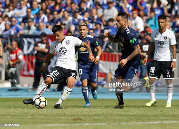 Claudio Baeza of Colo Colo fights for the ball with Mauricio Pinilla of U de Chileduring a match between U de Chile and Colo Colo as part of Torneo...