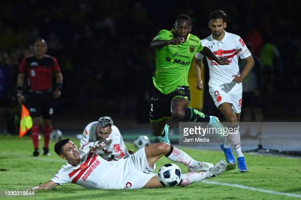 Claudio Baeza of Toluca fights for the ball with Fabian Castillo of Juarez during the 1st round match between FC Juarez and Toluca as part of the...