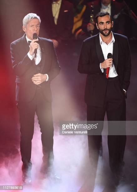 Claudio Baglioni and Marco Mengoni on stage during the second night of the 69th Sanremo Music Festival at Teatro Ariston on February 06, 2019 in...