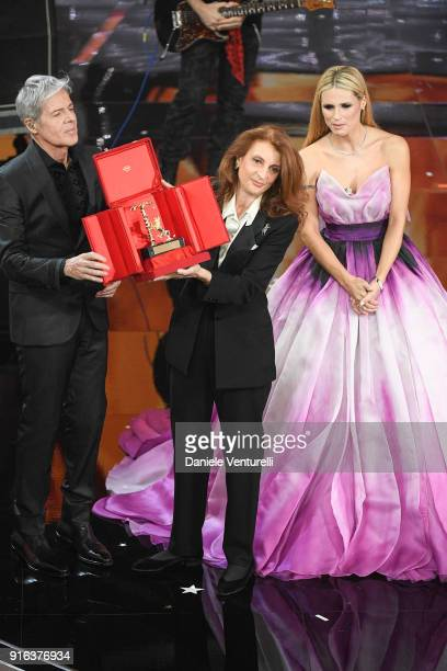 Claudio Baglioni Michelle Hunziker and Martina Corgnati with the Career award for singer Milva during the fourth night of the 68 Sanremo Music...
