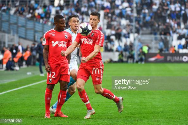 Claudio Beauvue of Caen Lucas Ocampos of Marseille and Frederic Guilbert of Caen during the Ligue 1 match between Marseille and Caen at Stade...