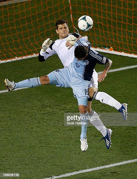 Claudio Bieler of Sporting Kansas City battles for the ball with keeper Tally Hall of the Houston Dynamo in the second half at BBVA Compass Stadium...