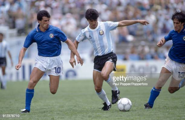 Claudio Borghi of Argentina is challenged by Salvatore Bagni of Italy during the FIFA World Cup match between Italy and Argentina at the Estadio...