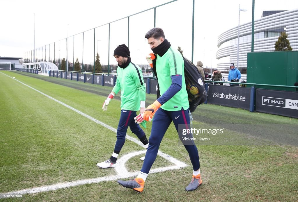 Claudio Bravo and Aro Muric walk to training at Manchester City Football Academy on February 8, 2018 in Manchester, England.