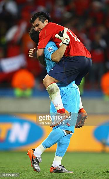 Claudio Bravo and Gary Medel of Chile celebrate their victory after the 2010 FIFA World Cup South Africa Group H match between Chile and Switzerland...