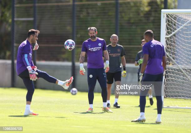 Claudio Bravo and Scott Carson of Manchester City in action during a training session at Estadio Jose Alvalade on August 14, 2020 in Lisbon, Portugal.