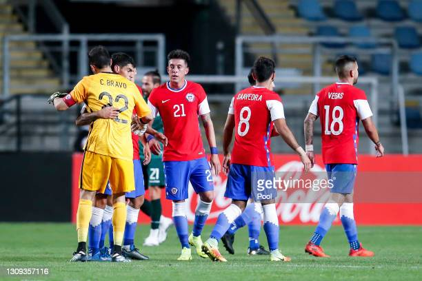 Claudio Bravo goalkeeper of Chile celebrates with teammates at the end of a friendly match between Chile and Bolivia at El Teniente Stadium on March...
