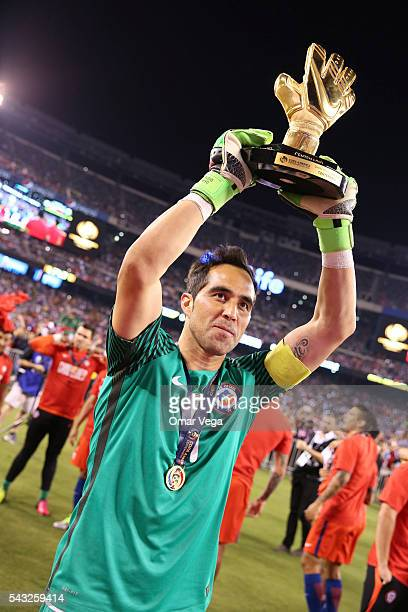 Claudio Bravo goalkeeper of Chile celebrates with the Golden Glove award after winning the championship match between Argentina and Chile at MetLife...