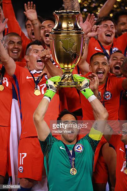 Claudio Bravo goalkeeper of Chile lifts the trophy after winning the championship match between Argentina and Chile at MetLife Stadium as part of...