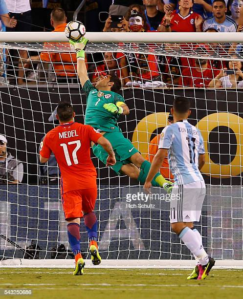 Claudio Bravo goalkeeper of Chile saves a header by Sergio Aguero of Argentina during the championship match between Argentina and Chile at MetLife...