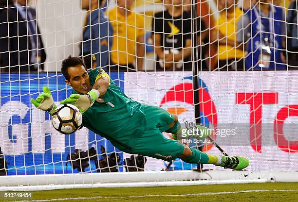Claudio Bravo goalkeeper of Chile stops a penalty shot by Lucas Biglia of Argentina in during the championship match between Argentina and Chile at...