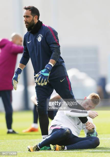 Claudio Bravo jokes with Kevin De Bruyne during training at Manchester City Football Academy on April 6 2018 in Manchester England