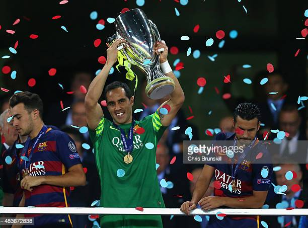 Claudio Bravo of Barcelona lifts the trophy as Pedro of Barcelona looks over the balcony during the UEFA Super Cup between Barcelona and Sevilla FC...
