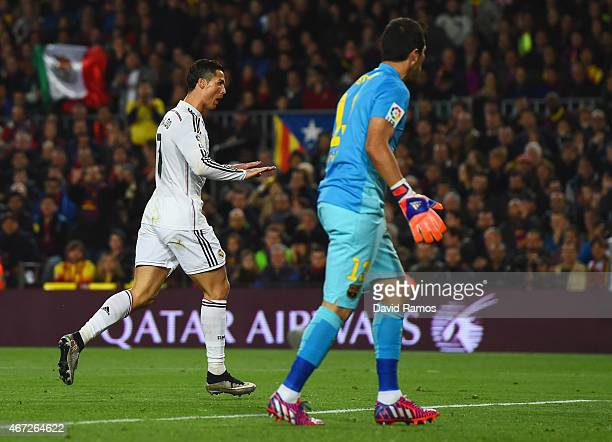 Claudio Bravo of Barcelona looks on as Cristiano Ronaldo of Real Madrid CF celebrates as he scores their first and equalising goal during the La Liga...