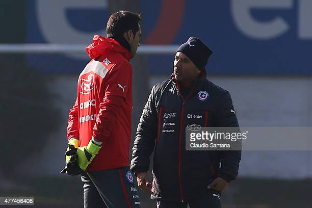 Claudio bravo of Chile and Jorge Sampaoli coach of Chile talk during a training session of Chile at Juan Pinto Duran on June 17 2015 in Santiago Chile