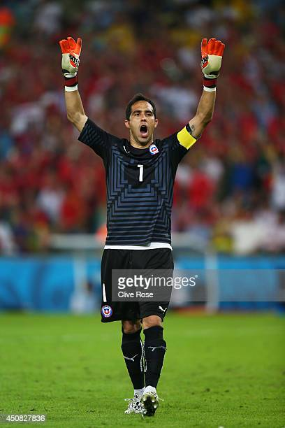 Claudio Bravo of Chile celebrates after defeating Spain 20 during the 2014 FIFA World Cup Brazil Group B match between Spain and Chile at Maracana on...