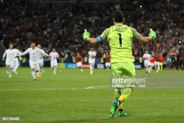 Claudio Bravo of Chile celebrates after winning a penalty shootout during the FIFA Confederations Cup Russia 2017 SemiFinal match between Portugal...
