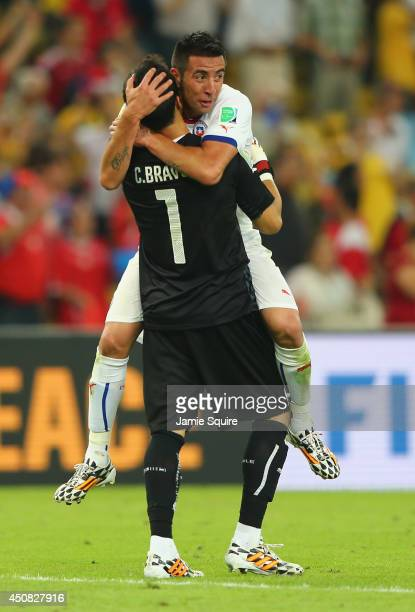 Claudio Bravo of Chile celebrates with Mauricio Isla after defeating Spain 20 during the 2014 FIFA World Cup Brazil Group B match between Spain and...