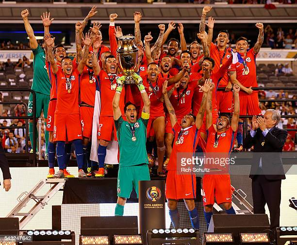 Claudio Bravo of Chile celebrates with teamamtes while lifting the trophy after winning the championship match between Argentina and Chile at MetLife...